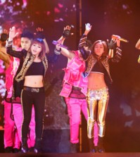 "K-Pop girl group 2NE1 performs during their concert as part of their world tour, in Hong Kong, March 22. 2NE1 will appear as a guest act in the final of ""America's Next Top Model."" (Yonhap)"