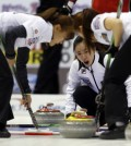 Korea's skip Kim Ji-sun, center, yells instructions to teammates during a game against Switzerland at the World Women's Curling Championships in Saint John, New Brunswick, Canada, Wednesday (KST). (Reuters-Yonhap)