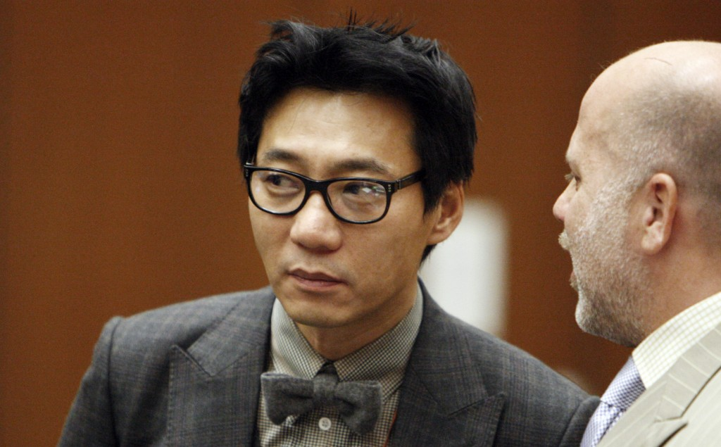 FILE-This Jan. 30, 2012 file photo shows Lee Young, one of the former founders of the Pinkberry yogurt chain stands with his attorney Philip Kent Cohen, right, during his arraignment in the Los Angeles Criminal Courts Building in Los Angeles. Lee has been convicted, Friday, Nov. 8, 2013,  of assault with a deadly weapon for striking a transient with a tire iron. Lee was sentenced Friday March 14, 2014, to seven years in prison for beating a homeless man with a tire iron in Los Angeles. (AP Photo/Los Angeles Times, Al Seib, Pool,File)