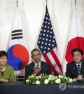 In this March 25, 2014 file photo, President Barack Obama meets with Japanese Prime Minister Shinzo Abe, right, and South Korean President Park Geun-hye at the U.S. Ambassador's Residence in the Hague, Netherlands. North Korea on Wednesday, March 26, 2014 (Yonhap)