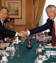 U.S. Defense Secretary Chuck Hagel, right, shakes hands with South Korea's Defense Minister Kim Kwan-jin during their bilateral meeting in Bandar Seri Begawan, Brunei, Wednesday, Aug. 28, 2013. (AP Photo/Vincent Thian/Yonhap)