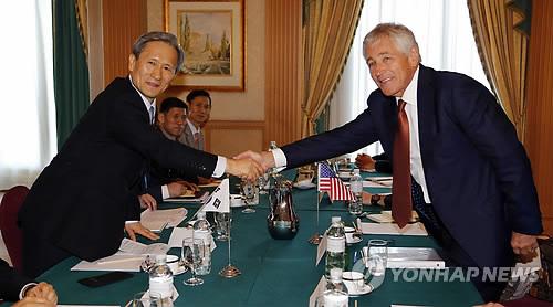 U.S. Defense Secretary Chuck Hagel, right, shakes hands with South Korea's Defense Minister Kim Kwan-jin during their bilateral meeting in Bandar Seri Begawan, Brunei, Wednesday, Aug. 28, 2013. (AP Photo/Vincent Thian/Yonhap)