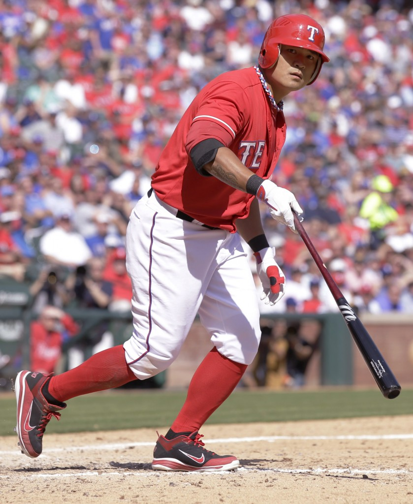 Texas Rangers' Shin-Soo Choo is walked during the seventh inning of an opening day baseball game against the Philadelphia Phillies at Globe Life Park, Monday, March 31, 2014, in Arlington, Texas.  (AP Photo/Tony Gutierrez)