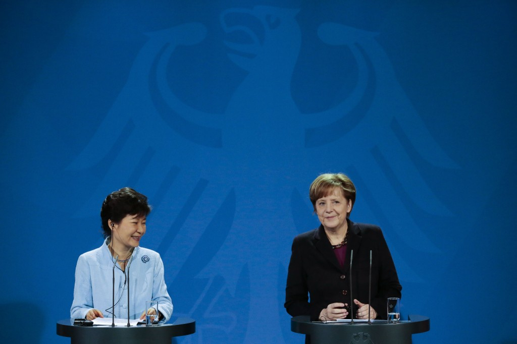 German Chancellor Angela Merkel, right, and the President of South Korea Park Geun-hye brief the media during a meeting at the chancellery in Germany in Berlin, Wednesday, March 26, 2014. The President of South Korea Park Geun-hye is on a three days official visit in Germany. (AP Photo/Markus Schreiber)