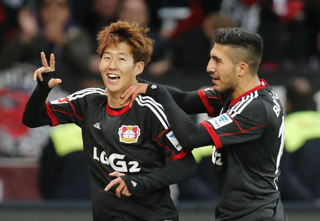 Leverkusen's Son Heung-min  of South Korea, left, and Leverkusen's Emre Can celebrate after scoring during the German first division Bundesliga soccer match between Bayer Leverkusen and Hamburger  SV  last year.