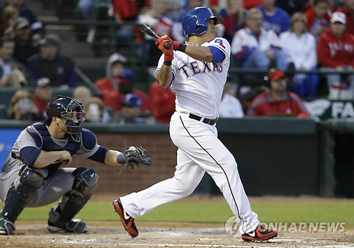 Choo Shin-soo hit his first home run as a Texas Ranger against his former team on Thursday. (AP)
