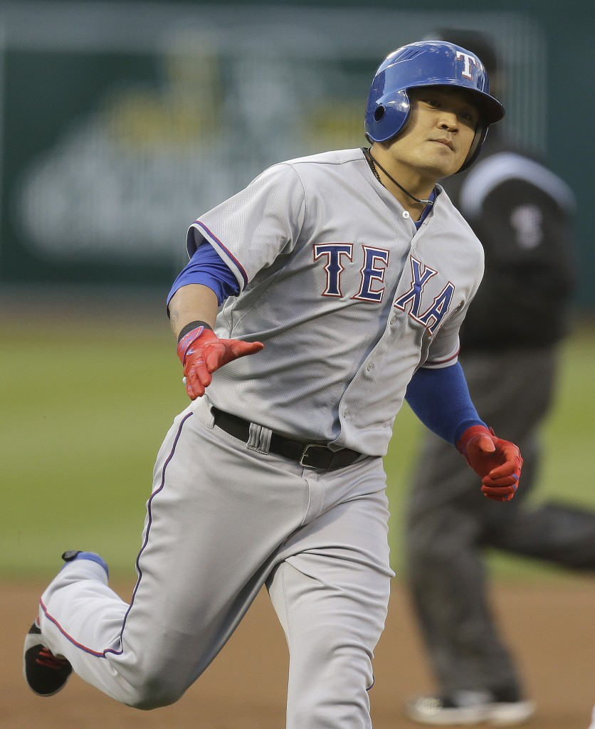 Texas Rangers'  Choo Shin-Soo of Korea runs the bases after hitting a home run off Oakland Athletics' Dan Straily in the first inning of a baseball game Monday, April 21, 2014, in Oakland, Calif. (AP Photo/Ben Margot)