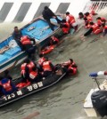 Coast Guard officers carry out rescue operations on the sunken ferry, Sewol, in waters off the southern coast, Wednesday. / Yonhap