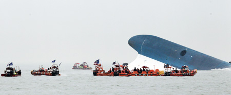 Only the bow of the capsized passenger ship, Sewol, remains above water in seas around 20 kilometers off the country's southern island of Jindo, Wednesday. / Yonhap