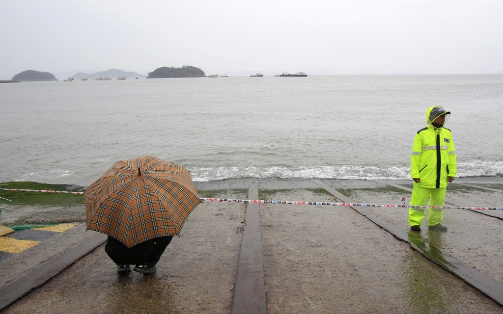 A relative of a passenger aboard the sunken Sewol ferry looks toward the sea as he awaits news on his missing loved one at a port in Jindo, South Korea, Sunday, April 27, 2014.  (AP Photo/Ahn Young-joon)