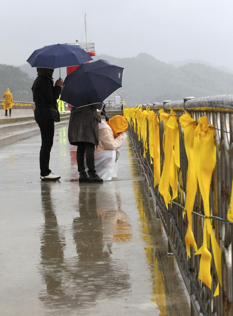 A relative of a passenger aboard the sunken Sewol ferry weeps as she awaits news on her missing loved one at a port in Jindo, South Korea.