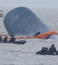 Rescue boats and ships from the Coast Guard approach the sunken ferry Sewol to search for passengers missing from the ship, Thursday. Rescue workers said the operation was hindered by bad weather conditions and high waves.  (Yonhap)