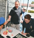 Tina Nieto, commanding officer of the LAPD's Olympic division, participates in the fundraiser Thursday.