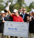 Noh Seung-yul, of South Korea, holds up his trophy with tournament officials after winning the Zurich Classic golf tournament at TPC Louisiana in Avondale, La., Sunday, April 27, 2014. (AP Photo/Bill Haber)