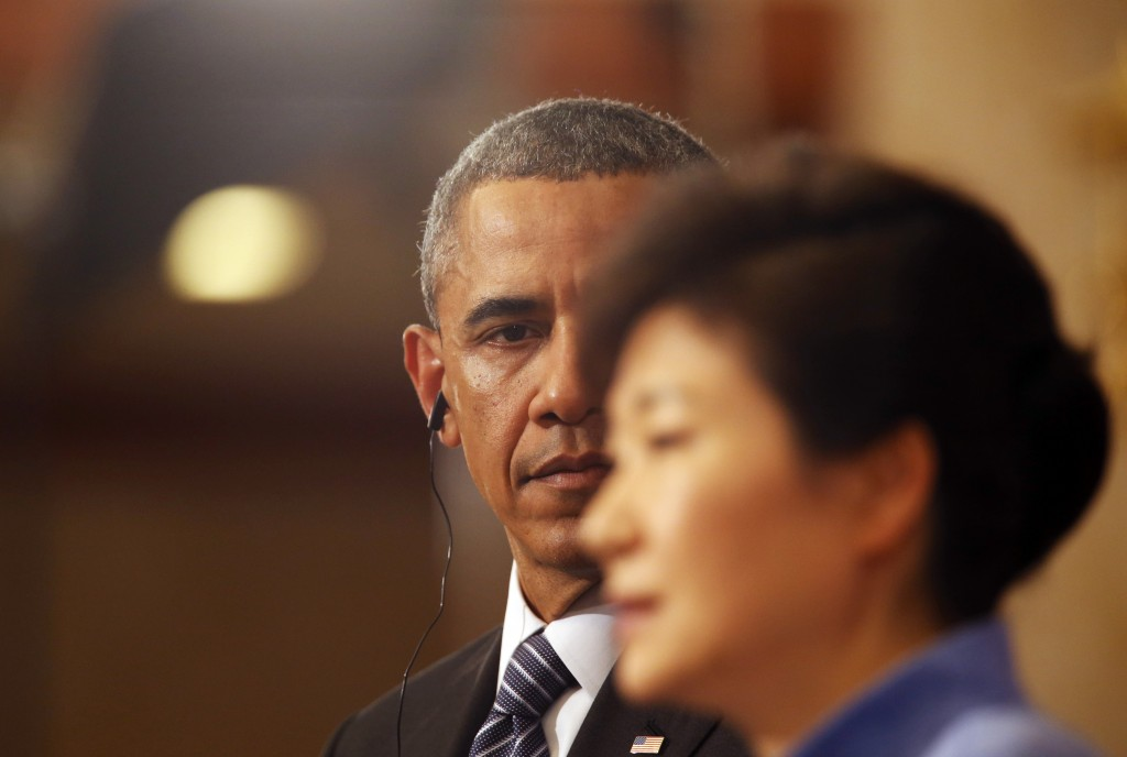 South Korean President Park Geun-hye, right, answers a report's question as U.S. President Barack Obama listens during a joint news conference following their meeting at the presidential Blue House in Seoul, Friday, April 25, 2014. (AP Photo/Kim Hong-Ji, Pool)