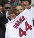 "In this Tuesday, April 1, 2014, file photo, Boston Red Sox designated hitter David ""Big Papi"" Ortiz takes a selfie with President Barack Obama, holding a Boston Red Sox jersey presented to him, during a ceremony on the South Lawn of the White House in Washington, where the president honored the 2013 World Series baseball champion Boston Red Sox. Ortiz tweeted the selfie to his followers Tuesday, and it was resent by tens of thousands, including Samsung, which retweeted it as an ad. The White House press secretary says Obama was not aware that the photo was part of a marketing stunt. (AP Photo/Carolyn Kaster, File)"