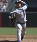 Los Angeles Dodgers pitcher Ryu Hyun-jin, from South Korea, throws against the San Francisco Giants during the first inning of a baseball game in San Francisco, Thursday, April 17, 2014. (AP Photo/Jeff Chiu)
