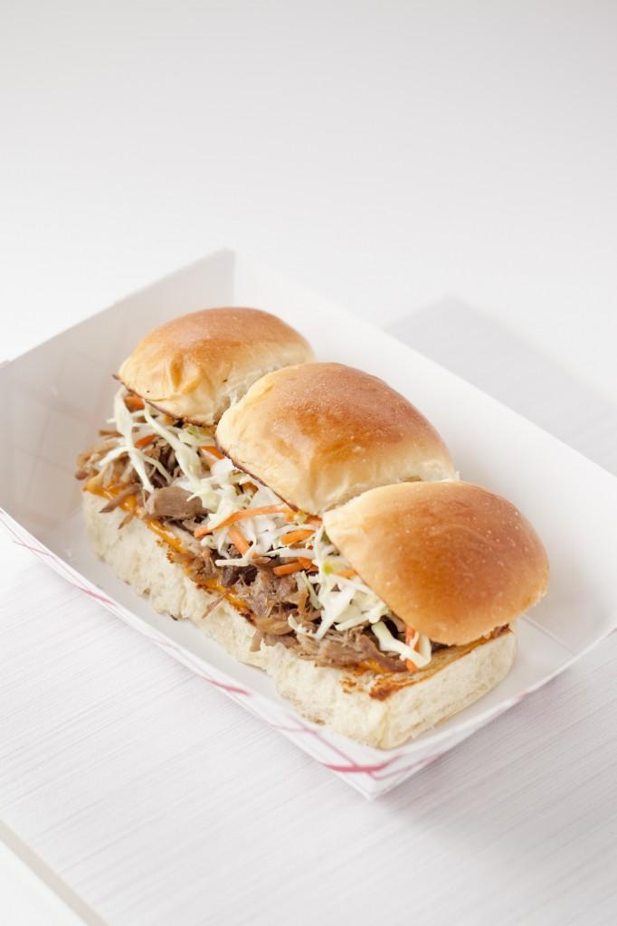 Marination Mobile's best-selling menu is their Aloha Sliders, Hawaiian-style braised kalua pulled pork stuffed in a Hawaiian sweet roll with Nunya Sauce and signature slaw.