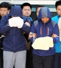 Crewmembers of the sunken ferry Sewol, including the chief engineer, two chief mates and a second mate, stand in front of reporters after being questioned during a judge's review of prosecutors' request for arrest warrants for abandoning passengers, at the Mokpo branch of the Gwangju District Court. (Yonhap)