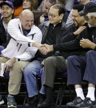 "FILE - In this Jan. 25, 2014, photo, then-Microsoft CEO Steve Ballmer, left, shakes hands with former NBA players Bill Russell, right, and ""Downtown"" Freddie Brown as Omar Lee looks on during an NCAA college basketball game between Washington and Oregon State in Seattle. An individual with knowledge of negotiations to sell the Los Angeles Clippers said Shelly Sterling has reached an agreement to sell the team to Ballmer for $2 billion. The individual, who wasn뭪 authorized to speak publicly, told The Associated Press on Thursday, May 29, 2014, that Ballmer and the Sterling Family Trust now have a binding agreement. The deal now must be presented to the NBA. (AP Photo/Elaine Thompson, File)"