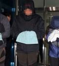 Crew members of the sunken ferry Sewol, including the chief engineer, two chief mates and a second mate, stand in front of reporters after being questioned during a judge's review of prosecutors' request for arrest warrants for abandoning passengers, at the Mokpo branch of the Gwangju District Court. (Yonhap)