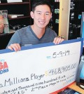 Sean Cho of C&D holds up the winning check. (Park Sang-hyuk, The Korea Times)