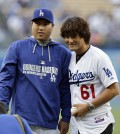 South Korean pitchers Ryu Hyun-jin and Park Chan Ho have both enjoyed success with the Dodgers. Now, a group of South Korean investors want to purchase 20 percent of the team. (AP)