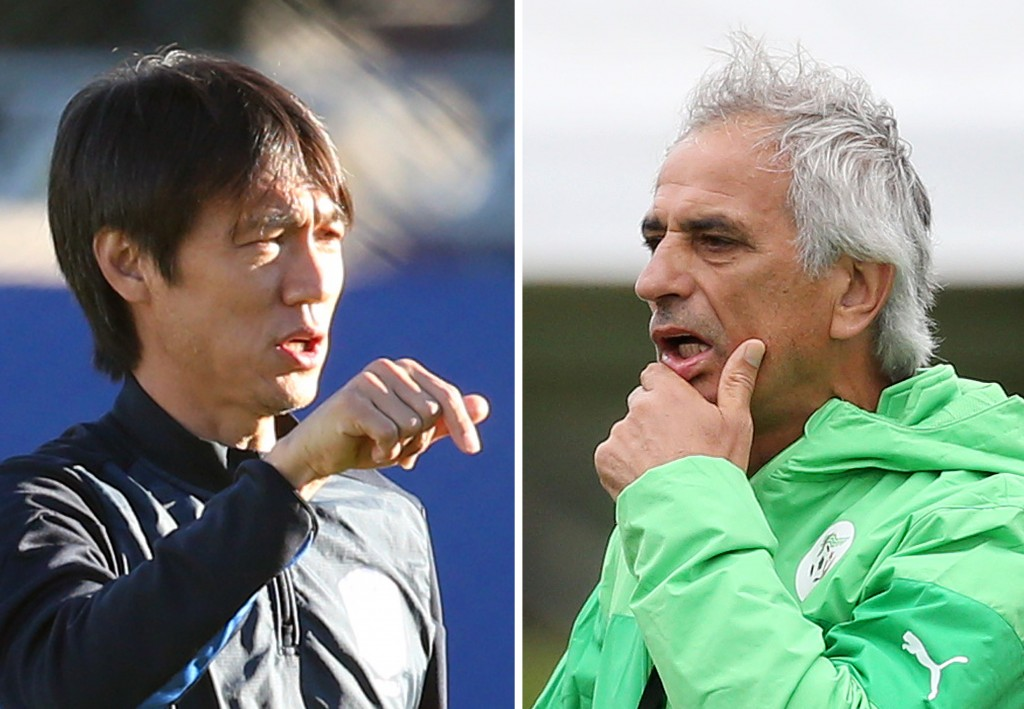 Korean manager Hong Myung-bo, left, and Algeria's boss Vahid Halilhodz. (Yonhap)