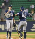 Charlie Shirek, left, and Kim Tae-koon celebrate the no-hitter. (Yonhap)