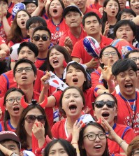 South Korean soccer fans react after Russian soccer team scored a goal against South Korea during  the group H World Cup soccer match between Russia and South Korea, at a public viewing venue in Seoul, South Korea, Wednesday, June 18, 2014. (AP Photo/Ahn Young-joon)