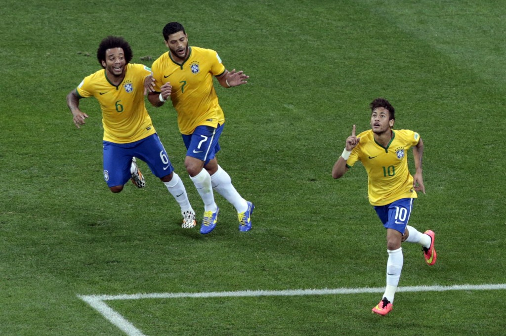 Brazil's Neymar, right, celebrates scoring his side's first goal during the group A World Cup soccer match between Brazil and Croatia, the opening game of the tournament, in the Itaquerao Stadium in Sao Paulo, Brazil, Thursday, June 12, 2014.  (AP Photo/Shuji Kajiyama)