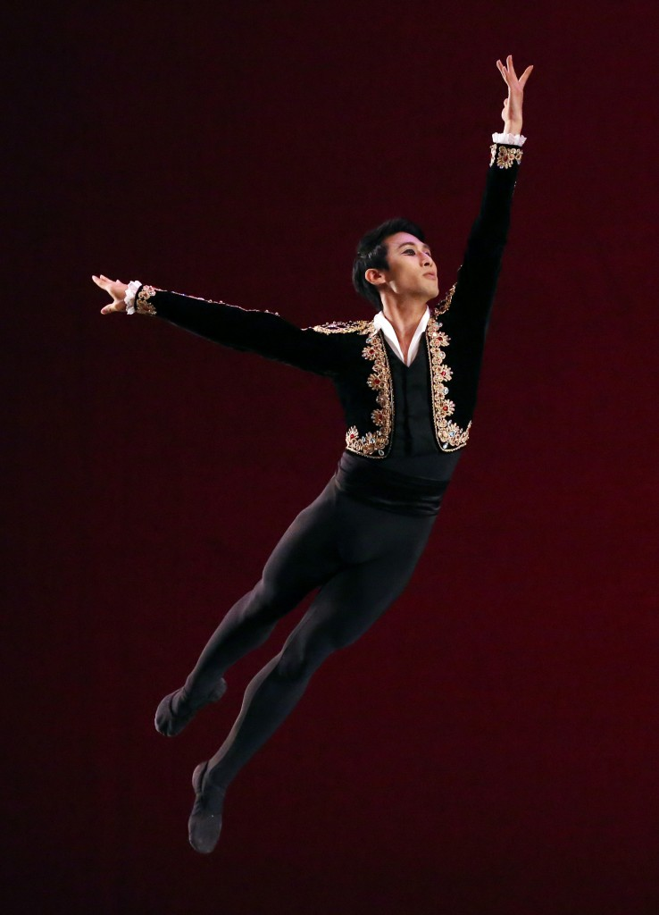 """Senior Men's gold medalist Jeong Hansol of the Republic of Korea performs a solo dance from """"Don Quixote, Grand Pas de Deux,"""" during the Awards Gala of the USA International Ballet Competition  in Jackson, Miss., Saturday, June 28, 2014. Dancers from around the world competed in the ballet competition, held every four years. The 2014 competition had 97 competitors vying for medals, scholarships, cash awards and company contracts in the """"Olympic-style"""" competition. (AP Photo/Rogelio V. Solis)"""