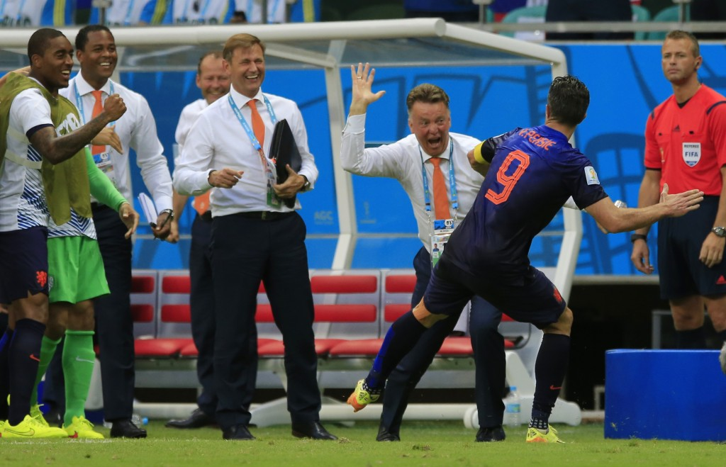 Netherlands' Robin van Persie celebrates with Netherlands' head coach Louis van Gaal after scoring a goal during the group B World Cup soccer match between Spain and the Netherlands at the Arena Ponte Nova in Salvador, Brazil, Friday, June 13, 2014. (AP Photo/Bernat Armangue)