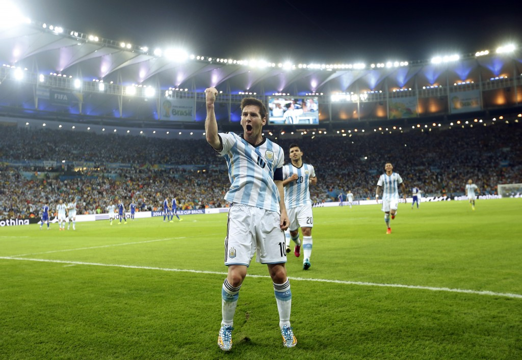 Argentina's Lionel Messi celebrates scoring his side's second goal during the group F World Cup soccer match between Argentina and Bosnia at the Maracana Stadium in Rio de Janeiro, Brazil, Sunday, June 15, 2014. (AP Photo/Victor R. Caivano)