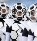 Actors perform during the opening ceremony before the group A World Cup soccer match between Brazil and Croatia, the opening game of the tournament, in the Itaquerao Stadium in Sao Paulo, Brazil, Thursday, June 12, 2014.  (AP Photo/Andre Penner)