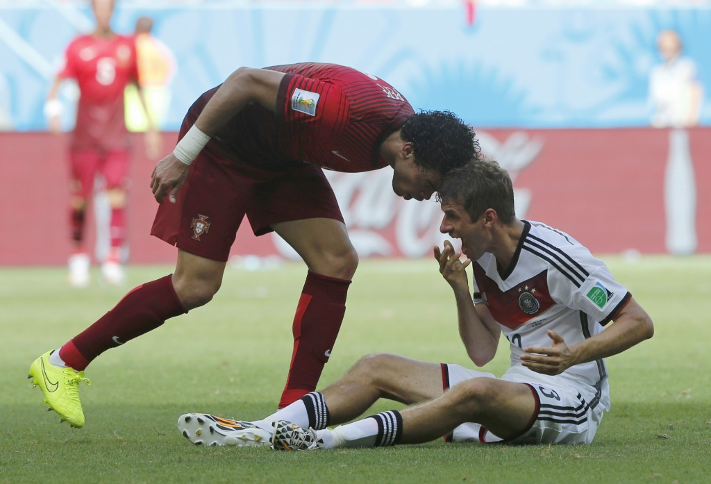 Portugal's Pepe, left, puts his head on Germany's Thomas Mueller during the group G World Cup soccer match between Germany and Portugal at the Arena Fonte Nova in Salvador, Brazil, Monday, June 16, 2014.  Pepe was red carded after this.  (AP Photo/Matthias Schrader)