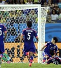 Colombia's Jackson Martinez, right, scores his side's third goal during the group C World Cup soccer match between Japan and Colombia at the Arena Pantanal in Cuiaba, Brazil, Tuesday, June 24, 2014. (AP Photo/Thanassis Stavrakis)