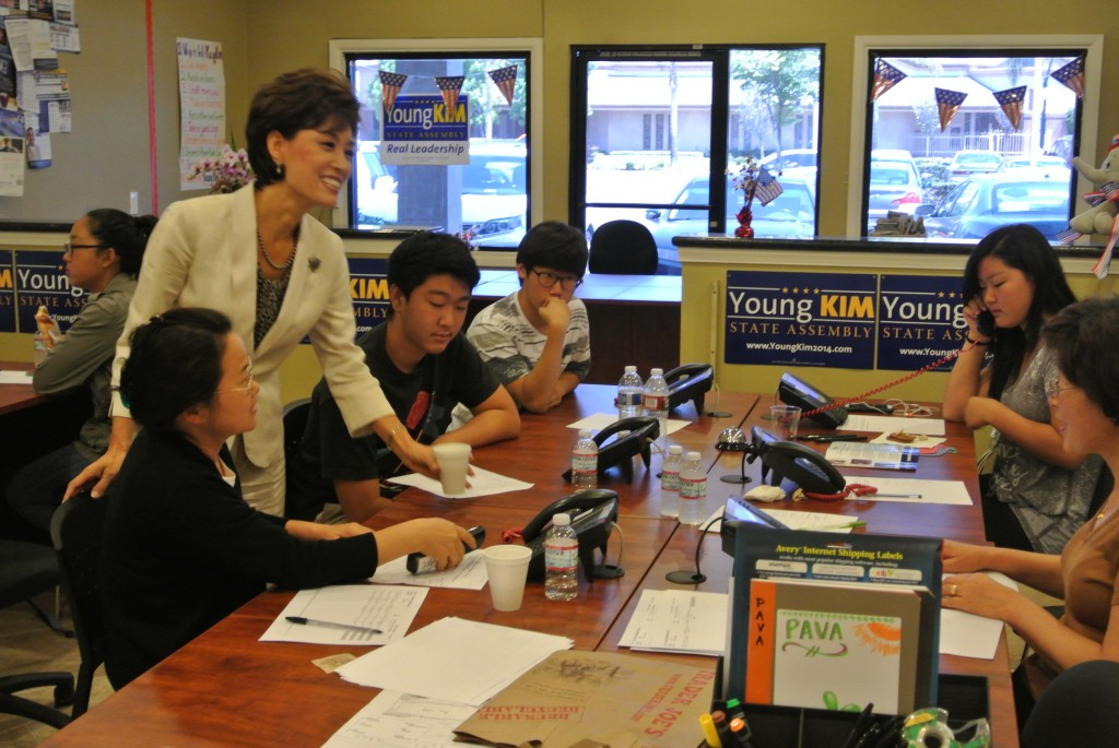 Young Kim, a Republican candidate for the 65th District seat in the State Assembly, encourages volunteer workers inside her Buena Park office.