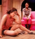 """Kahyun Kim (left) and Taylor Hawthorne in """"Hit"""" at the Los Angeles Theatre Center. (Photo Ed Krieger, courtesy of LATC)"""