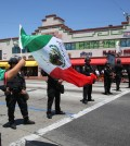 Police officers block a street as Mexican soccer fans rally after the telecast of the 2014 World Cup Brazil between Brazil vs Mexico in Huntington Park, Calif., on Tuesday, June 17, 2014. Brazil failed to beat Mexico for the first time at a World Cup, held to a 0-0 draw in Fortaleza Tuesday in their second game in Group A. (AP Photo/Nick Ut)