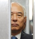 The face of troubled Prime Minister nominee Moon Chang-keuk is seen between closing elevator doors. He finally withdrew his name Tuesday.