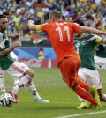 Netherlands' Arjen Robben, center, goes down to win the decisive penalty. (AP)