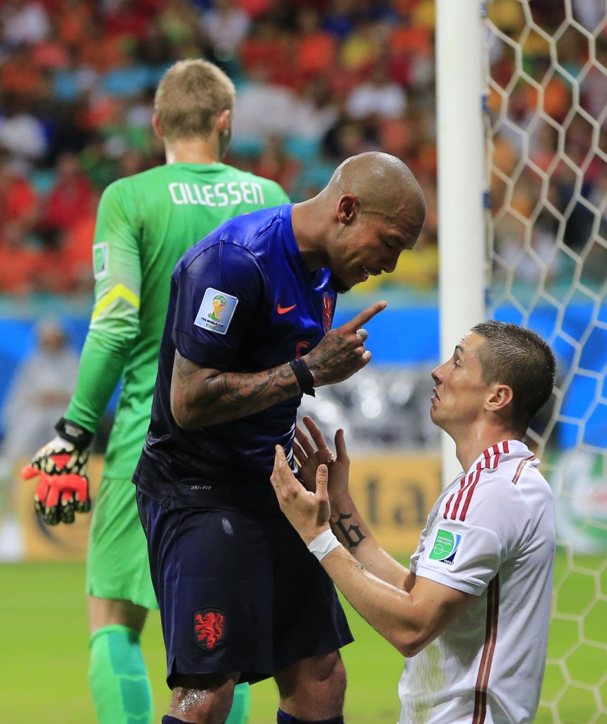 Netherlands' Nigel de Jong, left, confronts Spain's Fernando Torres, right, during the group B World Cup soccer match between Spain and the Netherlands at the Arena Ponte Nova in Salvador, Brazil, Friday, June 13, 2014. (AP Photo/Bernat Armangue)