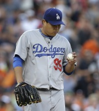 Los Angeles Dodgers pitcher Hyun-Jin Ryu looks at the ball against the Detroit Tigers in the second inning of a baseball game in Detroit, Tuesday, July 8, 2014. (AP Photo/Paul Sancya)