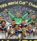 German players celebrate with the trophy after the World Cup final soccer match between Germany and Argentina at the Maracana Stadium in Rio de Janeiro, Brazil, Sunday, July 13, 2014. Germany won the match 1-0. (AP Photo/Matthias Schrader)