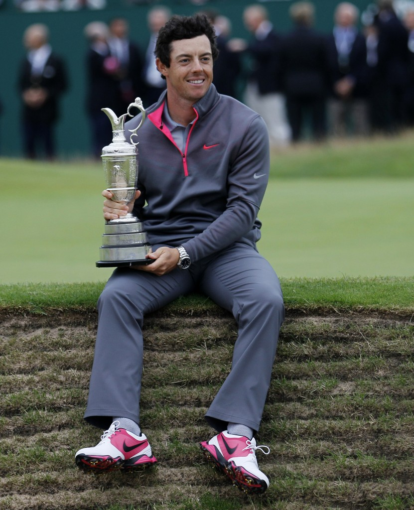 Rory McIlroy of Northern Ireland holds the Claret Jug trophy after winning the British Open Golf championship at the Royal Liverpool golf club, Hoylake, England, Sunday July 20, 2014. (AP Photo/Peter Morrison)