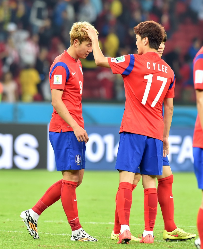 Son Heung-min, left, is about to walk away with the World Cup of hair title. (Newsis)