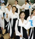 A squad of North Korean cheerleaders arrive at Incheon International Airport on Aug. 31, 2005, to attend the 16th Asian Athletics Championships in Incheon. North Korea said on July 7, 2014, it will dispatch a cheerleading contingent to the Incheon Asian Games in September along with its athletes to help improve inter-Korean relations and to show Pyongyang's commitment to unification. (Yonhap)