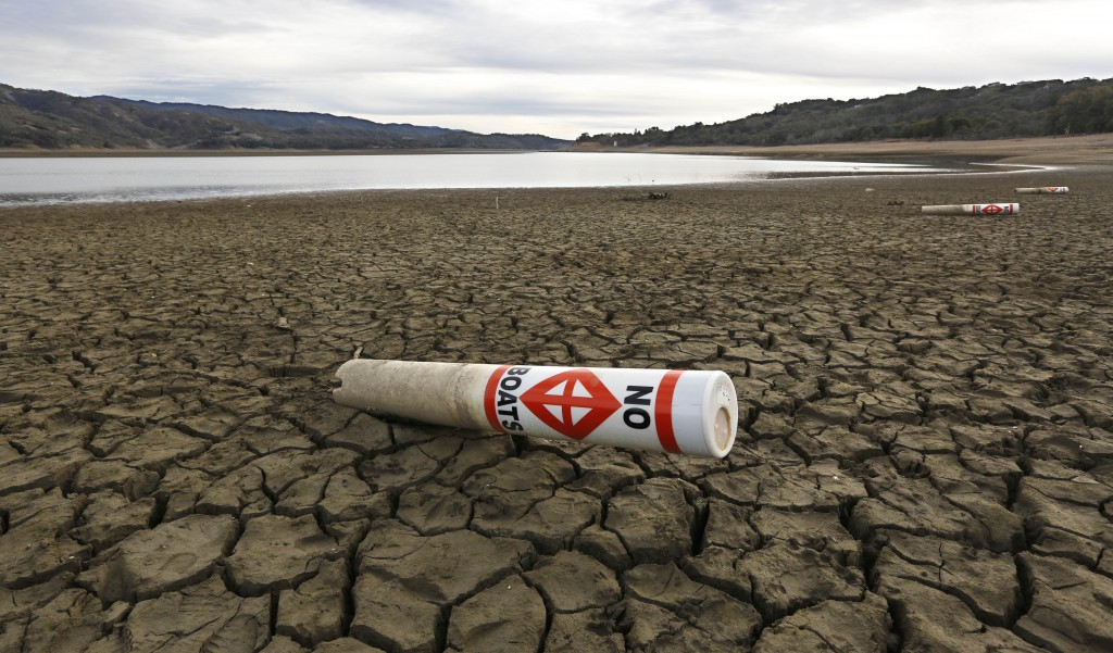 A warning buoy sits on the dry, cracked bed of Lake Mendocino near Ukiah, Calif.  (AP / Rich Pedroncelli)