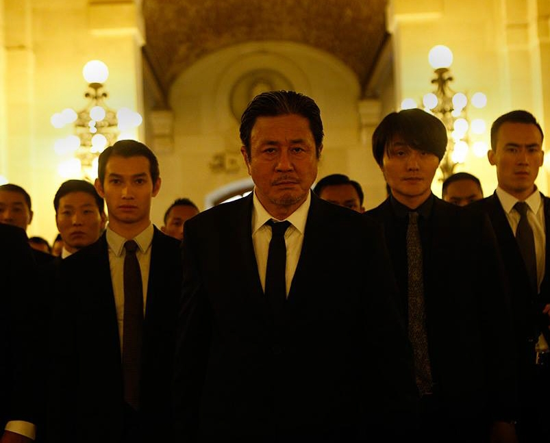 "Choi Min-sik, center, in ""Lucy."""